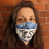 "Tess Poe wearing Blue and white ""Hello, my name is"" face mask"