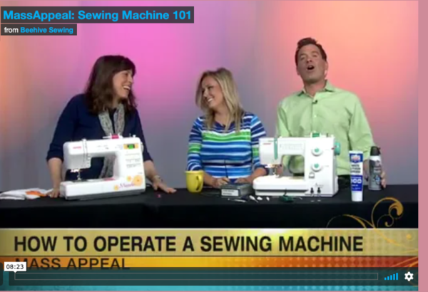 Screenshot from TV of three people and 2 sewing machines